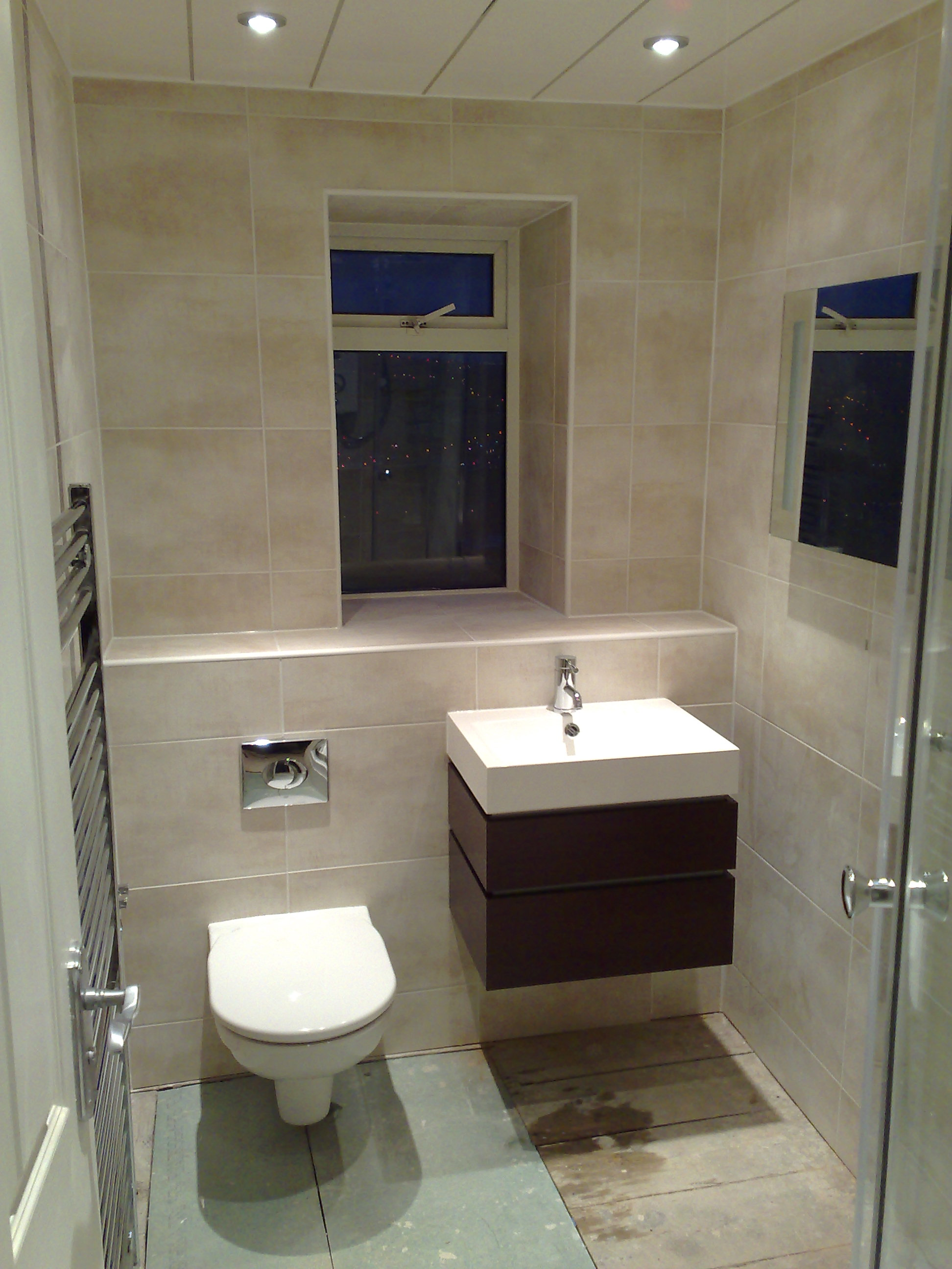 Wall hung bathroom suites - Shower Room Fitted With Concealed Toilet C